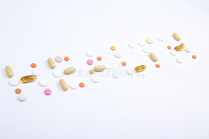 Health word text made of colorful pills. Health word text made of colorful tablets, pills and capsules over white stock photos