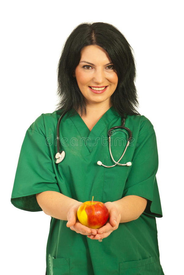 Health worker offering apple