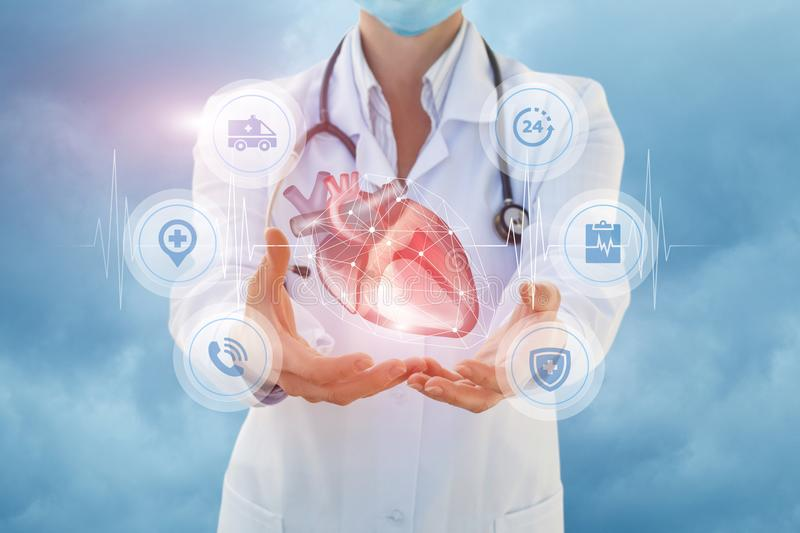Health worker shows a heart in hands. stock photo