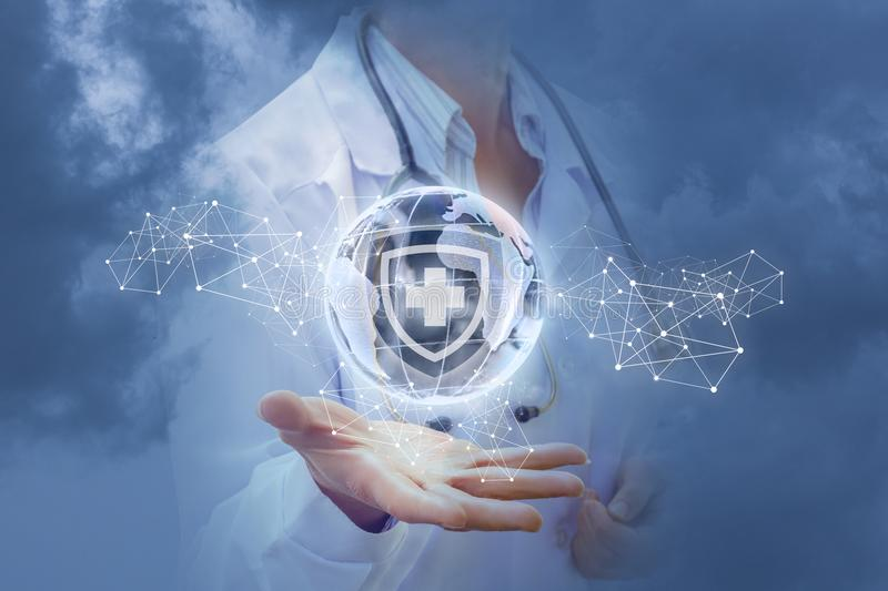 Health of the world in the hands of a medic. Health of the world in the hands of a medic in the sky stock photography