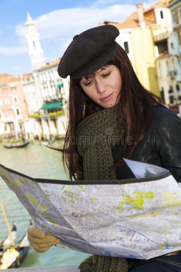 Healthcare. Tourist attractions: woman reading a tourist map in Venice royalty free stock images