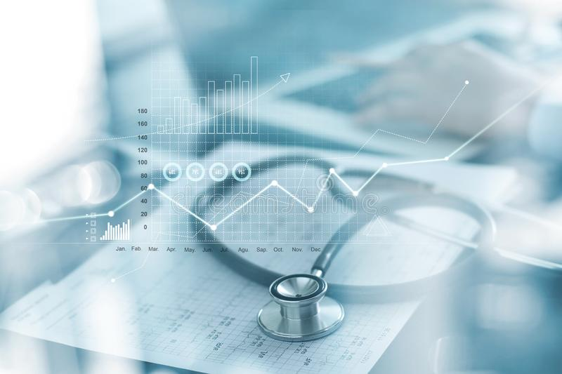 Healthcare business graph and Medical examination and businessman analyzing data and growth chart on blured background stock photos
