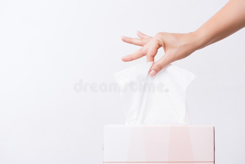 Healthcare concept. Woman hand picking white tissue paper from tissue box.  stock photo