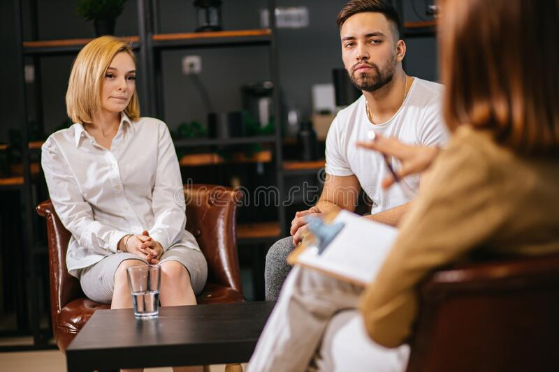 Healthcare concept: young caucasian couple visit professional psychologist doctor. Healthcare concept: married couple visit psychologist doctor. men and women stock photos