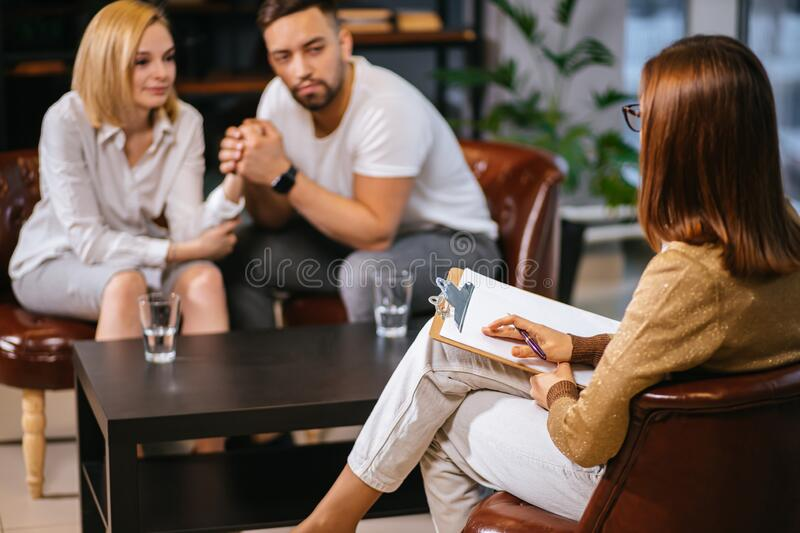 Healthcare concept: young caucasian couple visit professional psychologist doctor. Healthcare concept: married couple visit psychologist doctor. men and women stock image