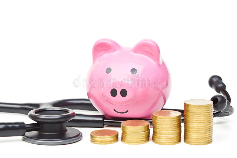 Healthcare cost concept. A stethoscope with pink piggy bank and golden coins arranged as a graph stock photos