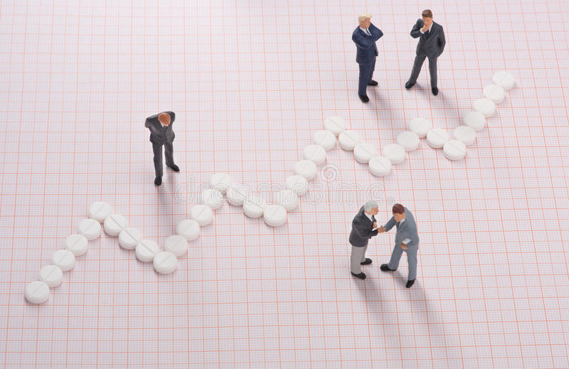 Healthcare costs. Businessmen negotiating medical investment and growth stock images