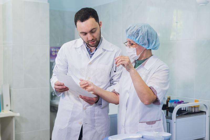 Healthcare: Doctor and patient discussing blood-test results royalty free stock photography