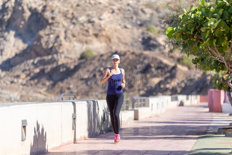 Healthcare lifestyle background with jogging hispanic girl royalty free stock photography