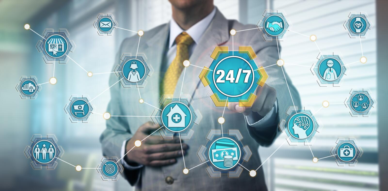 Healthcare Manager Touching 24/7 Service Button royalty free stock image