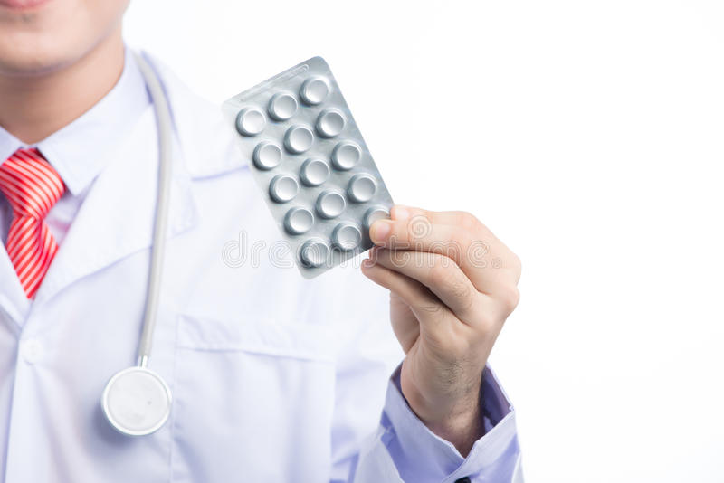 Healthcare and medical concept - asian mel doctor with blister p stock images