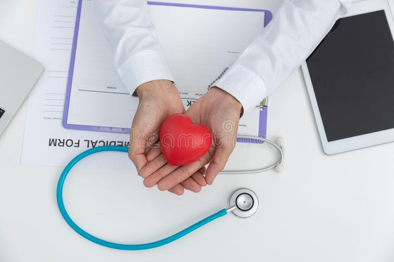 Healthcare and medical concept, Closeup stethoscope ,injection needle and heart on medical treatment chart.  stock image