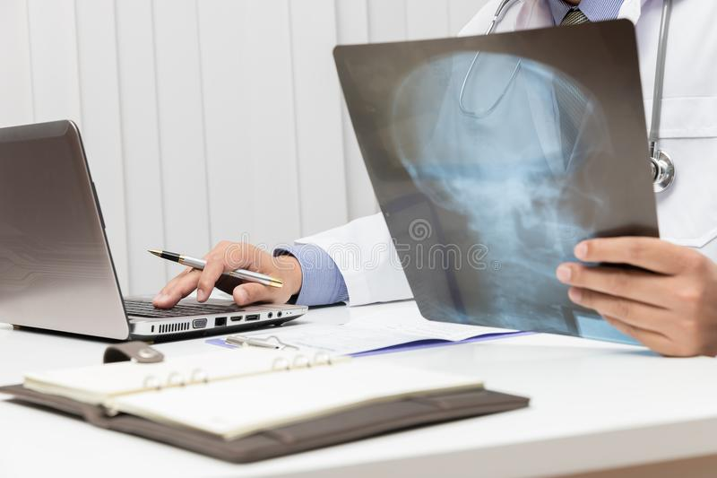 Healthcare and medical concept, Doctor looking head x-ray film in office royalty free stock photo