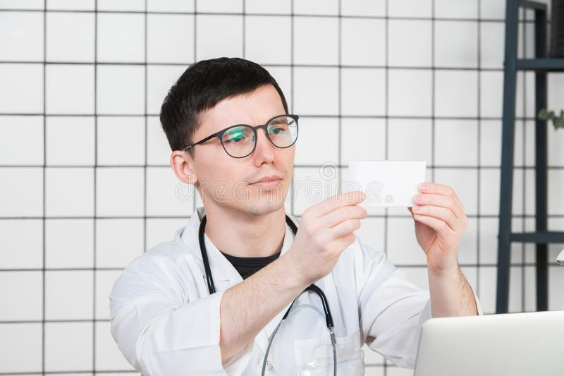 Healthcare and medical concept - doctor with pill box in hospital royalty free stock photos