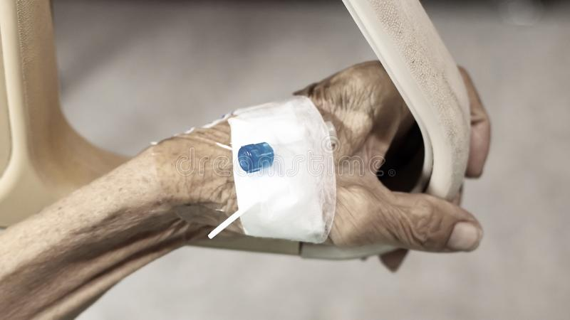 Healthcare and medical concept. Elder with injection needle. Blur background royalty free stock image