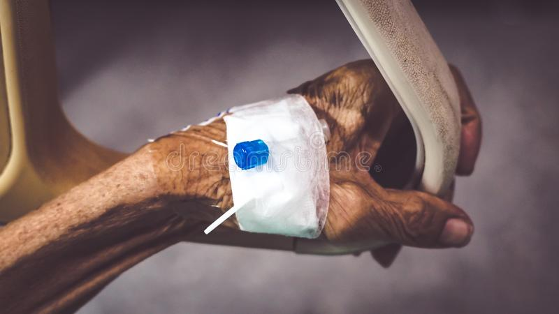 Healthcare and medical concept. Elder with injection needle. For healing royalty free stock photography