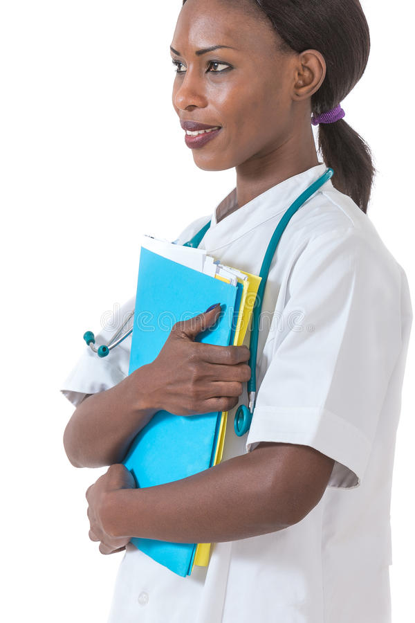Healthcare and medical concept - smiling african female doctor in hospital stock images