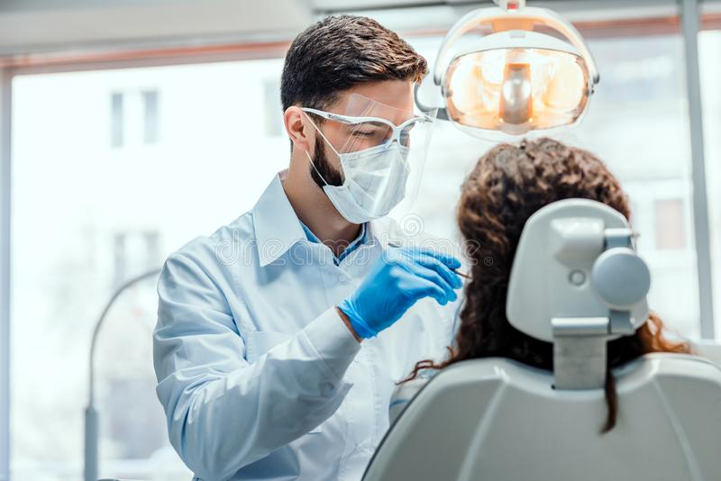 Healthcare and medicine concept.Young dentist working with the female patient in a modern hospital royalty free stock images