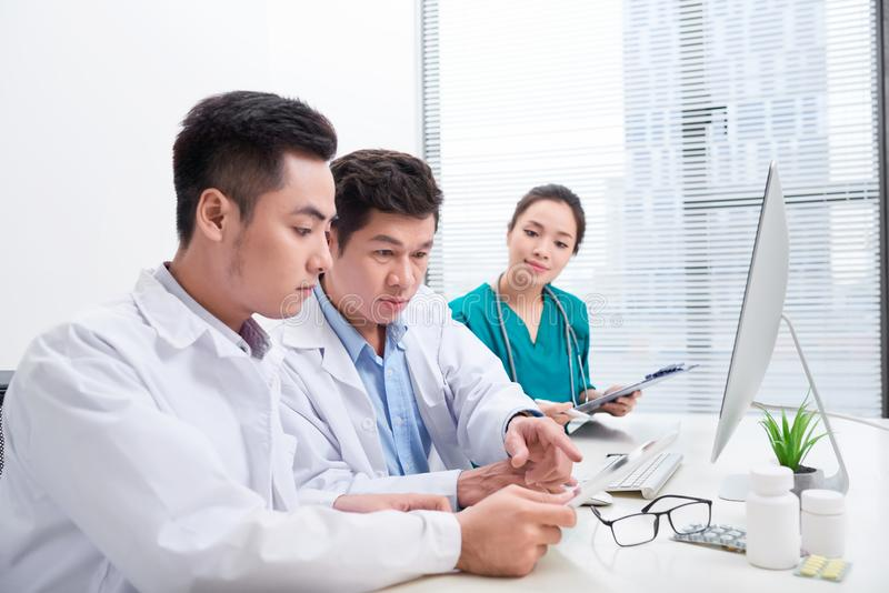 Healthcare people group. Professional doctor working in hospital office or clinic with other doctors, nurse and surgeon stock photo