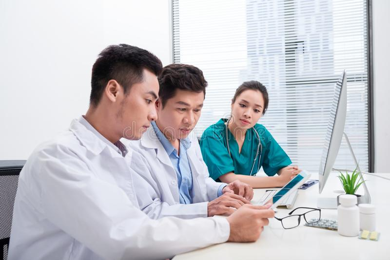 Healthcare people group. Professional doctor working in hospital office or clinic with other doctors, nurse and surgeon.  stock photography