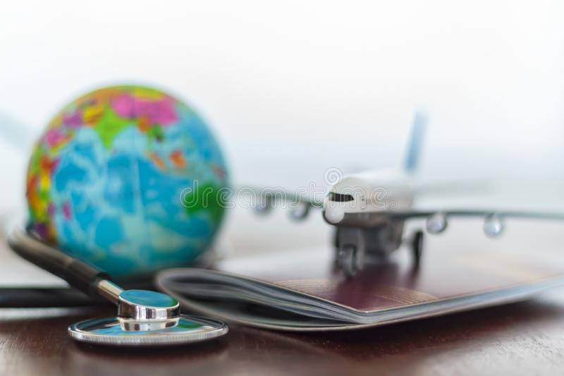 Healthcare and travel insurance concept. Stethoscope , passport document, airplane and globe.  royalty free stock photos