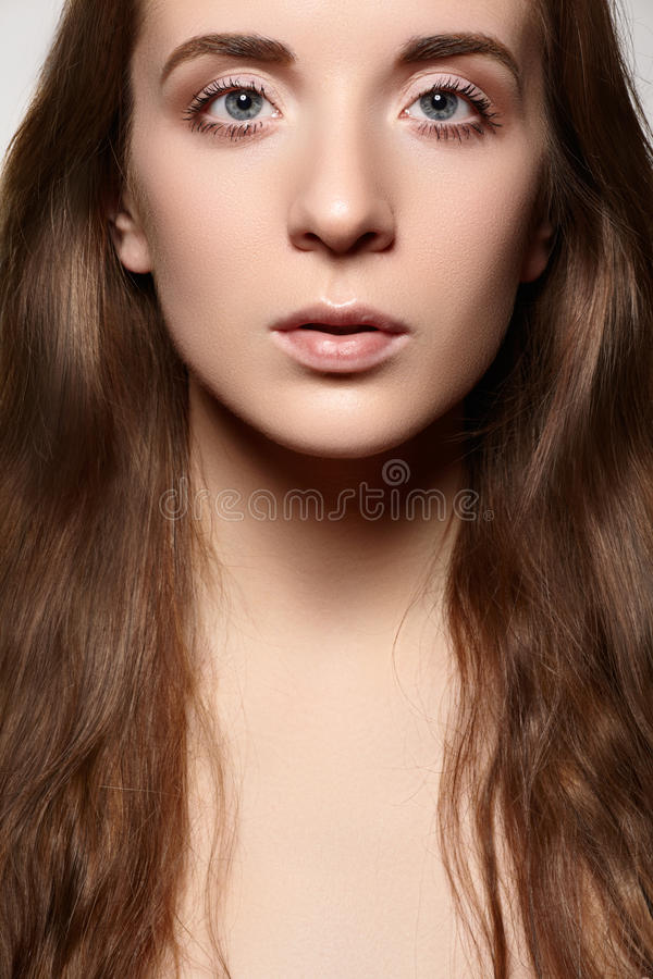 Healthcare & wellness. Beautiful woman with daily make-up, long shiny hair. Healthcare, spa, wellness. Beauty and skin care. Close-up portrait of beautiful woman stock images