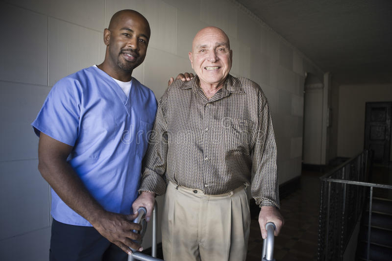 Healthcare Worker With Elderly Man. Portrait of a male healthcare worker with elderly man royalty free stock image
