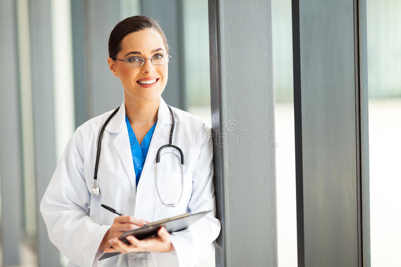 Healthcare Worker Writing Report Stock Photo