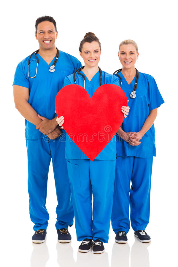 Healthcare workers heart symbol. Group of healthcare workers with heart symbol isolated on white background royalty free stock image