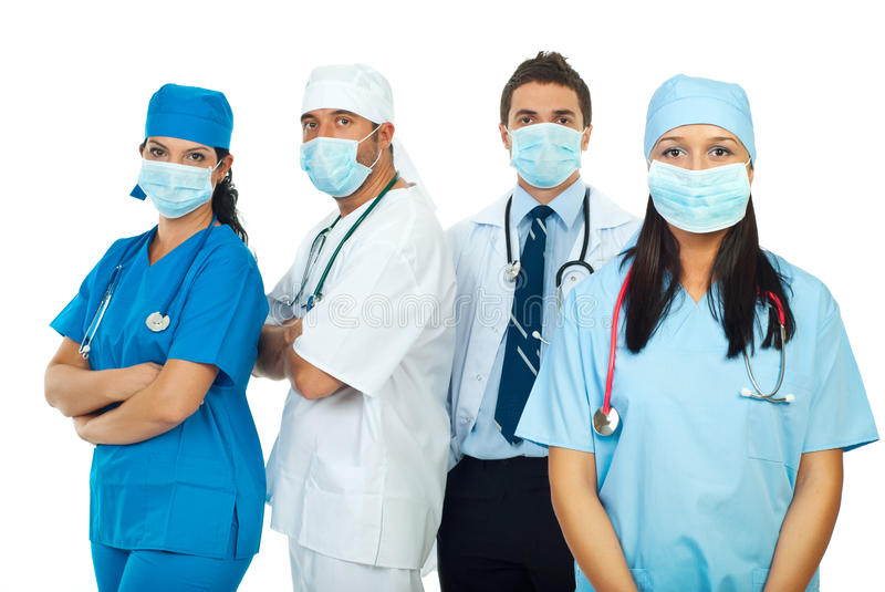 Healthcare workers with protective mask stock photography
