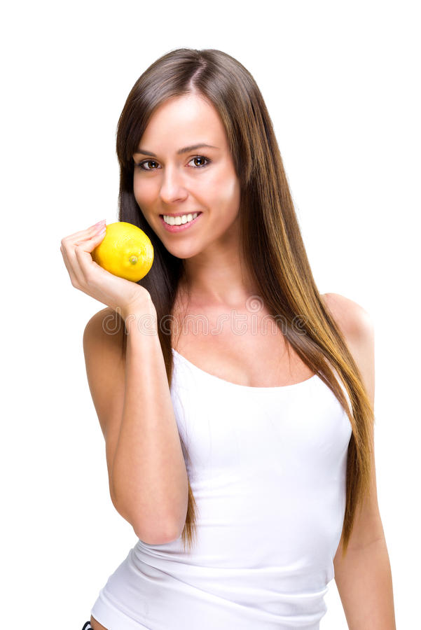 Healthful łasowania piękna kobieta trzyma pomarańcze fotografia royalty free