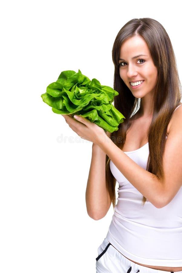 Healthful piękna dysponowana kobieta trzyma sałatki zdjęcia royalty free