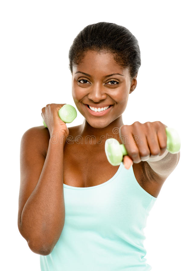 Healthy African American woman excercising with dumbbells isolated on white background stock image