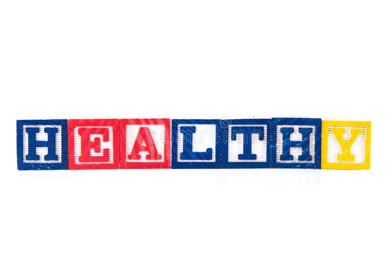 Healthy - Alphabet Baby Blocks on white royalty free stock photo