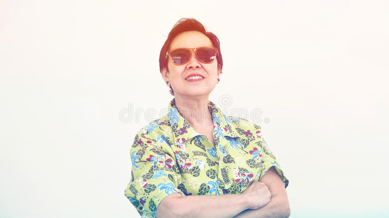 Healthy Asian senior woman looking forward for holiday travel tr. Healthy Asian senior woman looking forward for holiday trip royalty free stock images