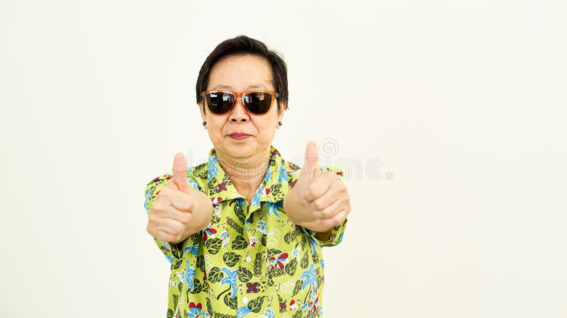 Healthy Asian senior woman looking forward for holiday travel tr. Healthy Asian senior woman looking forward for holiday trip royalty free stock image