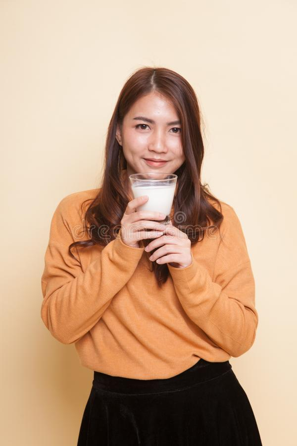 Healthy Asian woman drinking a glass of milk. royalty free stock images