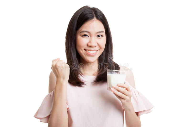 Healthy Asian woman drinking a glass of milk. Healthy Asian woman drinking a glass of milk isolated on white background stock photo