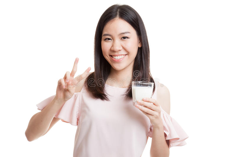 Healthy Asian woman drinking a glass of milk show victory sign. Healthy Asian woman drinking a glass of milk show victory sign isolated on white background stock images