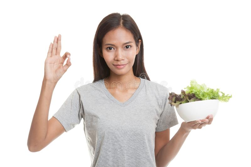 Healthy Asian woman show OK with salad. Healthy Asian woman show OK with salad isolated on white background royalty free stock photos