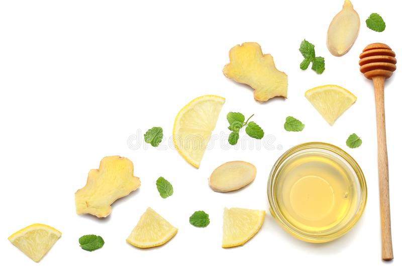 Healthy background. sliced ginger, honey and lemon isolated on white background top view royalty free stock image