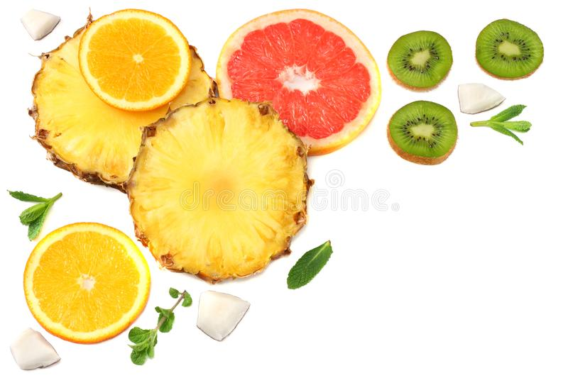 healthy background. slices of grapefruit, kiwi fruit, orange and pineapple isolated on white background top view stock photos