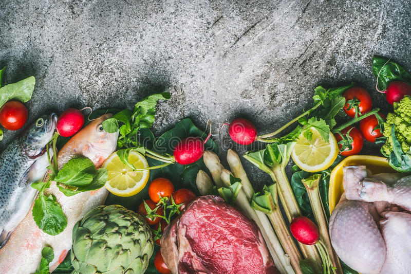 Healthy balanced eating and diet nutrition concept. Various organic foods ingredients: fish,meat,poultry,chicken,vegetables and gr. Eens seasoning on gray stone stock photos