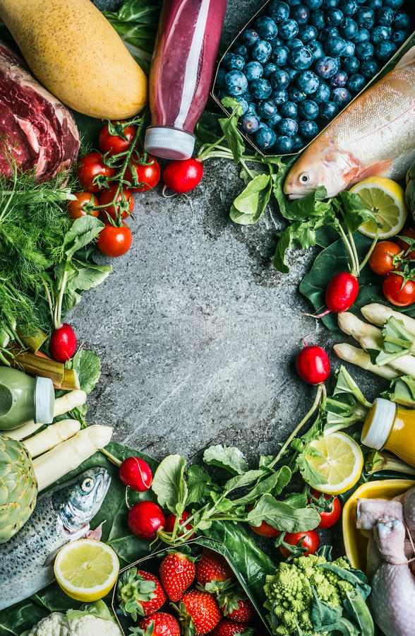 Healthy balanced food ingredients for tasty clean cooking and eating: vegetables, fruits,berries, meat,chicken and fish on vintage. Background, top view, frame stock images