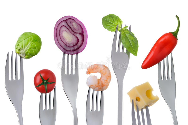 Healthy balanced food on white. Fresh healthy balanced food on forks isolated on a white background stock images