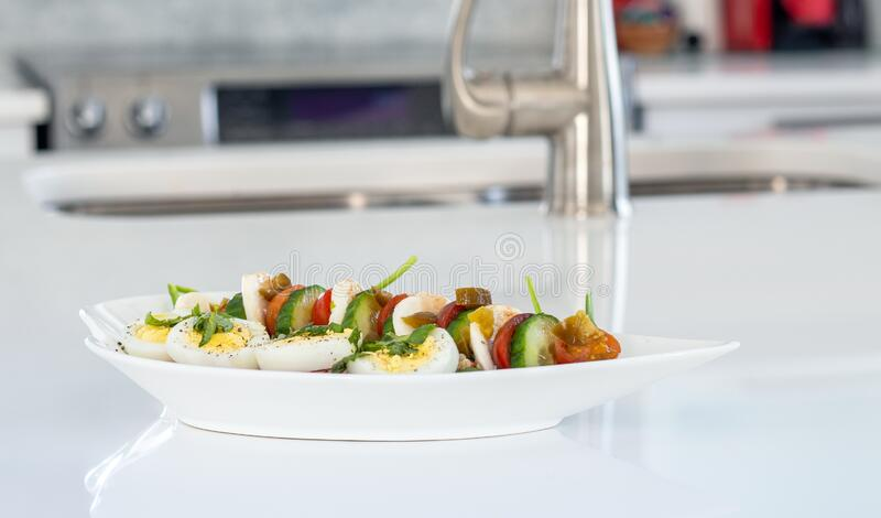Healthy and balanced meal of egg salad with bocconccini and cucumber royalty free stock image