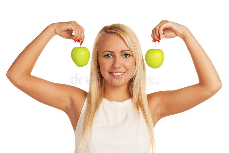 Healthy beauty. Smiling girl with two apples on isolated white background stock photography
