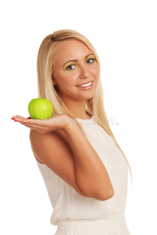 Healthy beauty. Smiling girl with apple on isolated white background royalty free stock photography