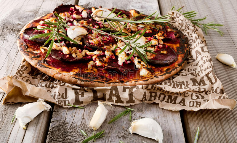 Healthy beetroot pizza royalty free stock photo