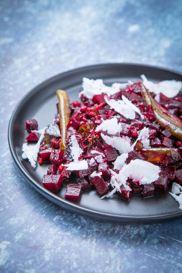 Healthy Beetroot Side Dish. Healthy Indian beetroot side dish on a dark plate and a grey background. Close up of beetroot poriyal on a grey marble background royalty free stock images
